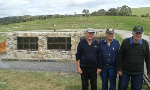 """• Foster Cemetery Trustees George Draeger, John Taylor and Norman """"Cobber"""" Sparkes are impressed by the workmanship of district tradespeople who helped build the newly extended """"cremorial"""" wall."""
