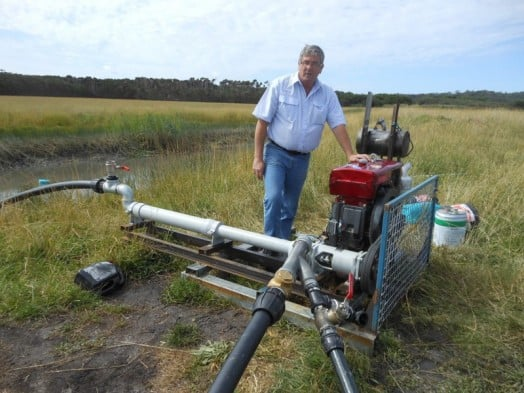 • Alex Moon, from the Yanakie Progress Association, at the newly installed pump on farmland in the southeast of Yanakie.