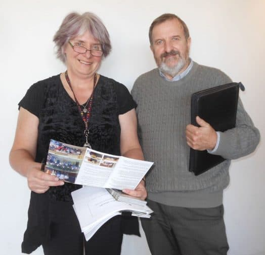 • Shire community strengthening officer Barbara Look and Graeme Green from the Corner Inlet Men's Shed look over the colour brochure promoting the Men's Shed movement across South and West Gippsland.