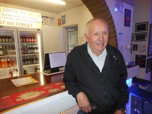 • Perce Brewer at the bar of the Foster RSL, where he is stepping down as secretary/manager to make way for a new generation.
