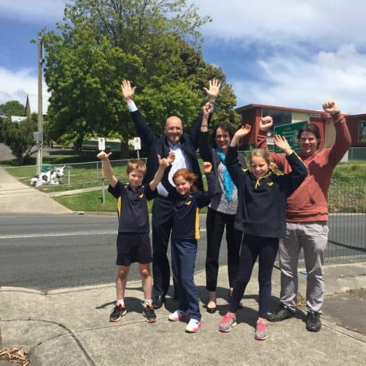• Member for Gippsland South Danny O'Brien, Member for Eastern Victoria Melina Bath, Fish Creek and District Primary School Acting Principal Dale Banks and students Tom Vuillermin, Grace Wilson and Gretta Paul celebrating the school crossing win.