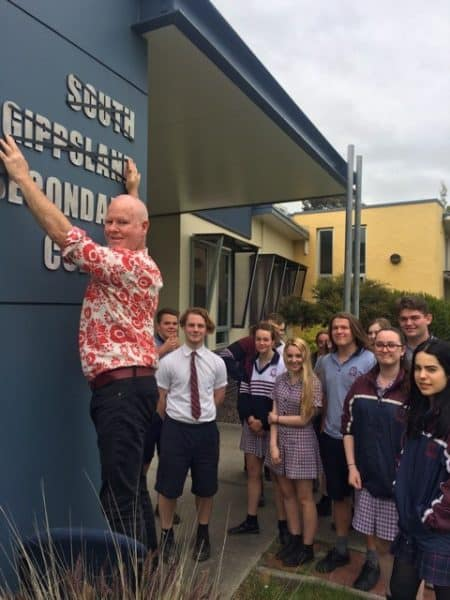• Out with the old – students watch on as principal Matt McPhee prepares for South Gippsland Secondary College to become known as Foster Secondary College.